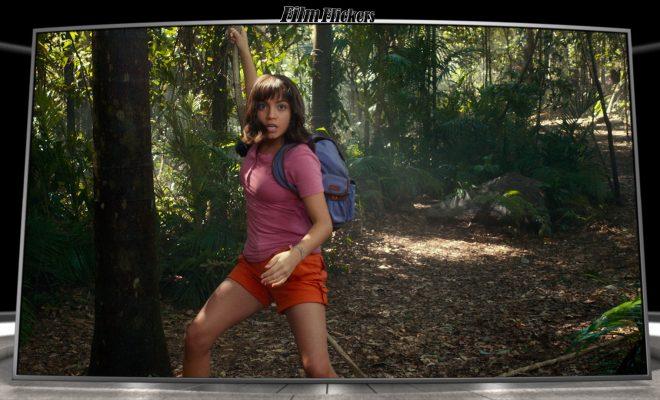 Image of Dora the Explorer singing on a vine landing on ground in jungle