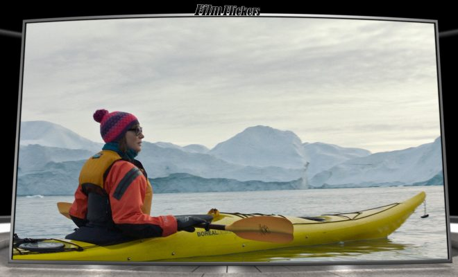 Image of Bernadette kayaking in the cold lake
