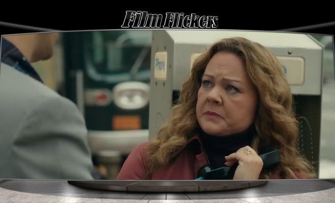 Image of Mellisa McCarthy as Kathy from The Kitchen holding a payphone looking intimidated