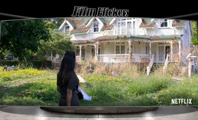 Image of woman looking at broken down Inn