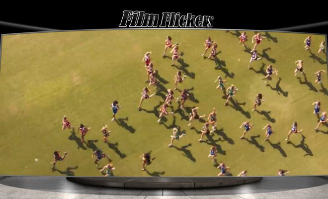Image of high school runners running across a field
