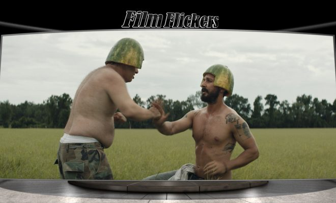 Image of two guys practice fighting with watermelon shells on their head
