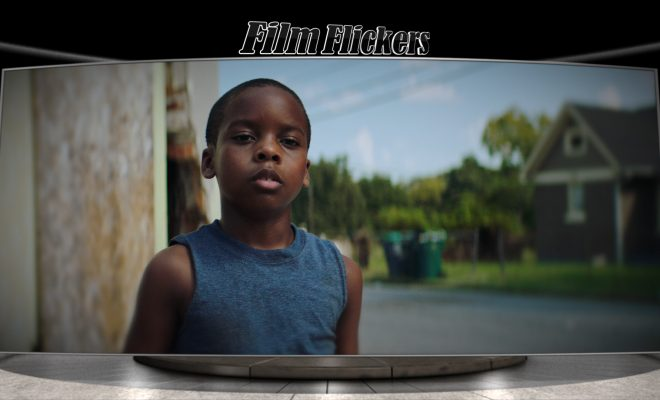 Image of little black kid on the side of the road