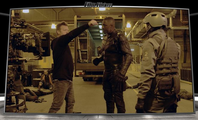 Image of Idris Elba getting taught what to do during scene of Hobbs & Shaw