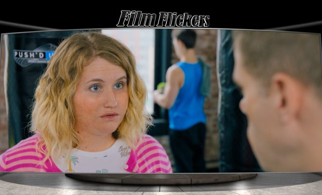 Image of movie title character talking to a fitness trainer