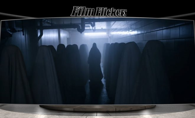 Image of ghost-like people in sheets walking down a hallway