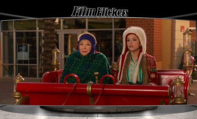 Image of Noelle and lady sitting inside Santa's sleigh