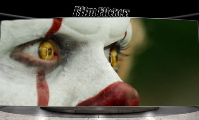 Image of close up on the clown IT's face