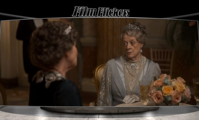 Image of Maggie smith SITTING DOWN DURING DOWNTON ABBEY SCENE