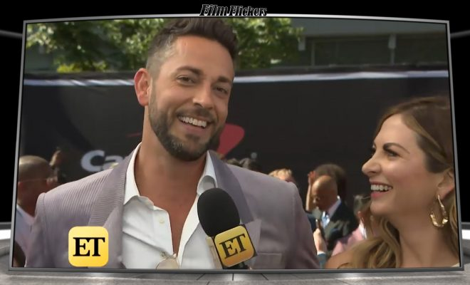 Image of Zachary Levi getting interviewed and ET reporter