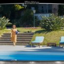 Image of actress Frankie walking to her pool