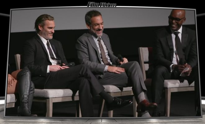Image of Joaquin Phoenix and Joker director with panel discussing the film