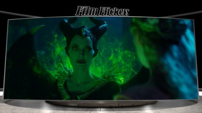 Image of Angelina Jolie as Maleficent glowing green and mad