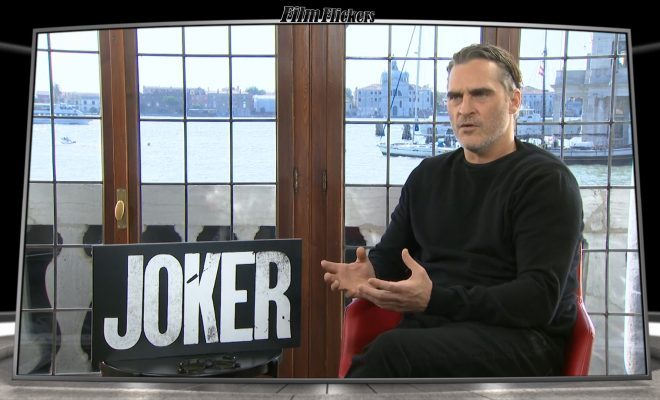 Image of Joaquin Phoenix getting interviewed about the Joker film