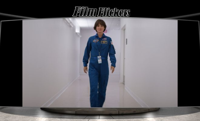 Image of Natalie Portman playing character Lucy, walking down a hall