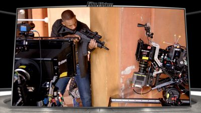 Image of behind the scenes making Gemini Man of Will Smith looking around the corner with gun with cameras around him