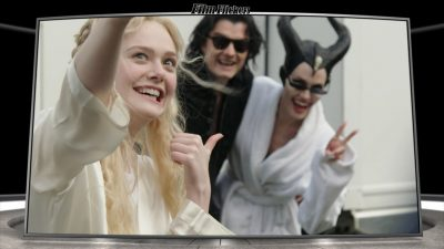 Image of Elle Fanning taking a silly selfie with costars