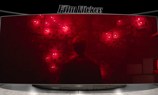 Image of a man looking at a map in the dark with red lights pinged on location
