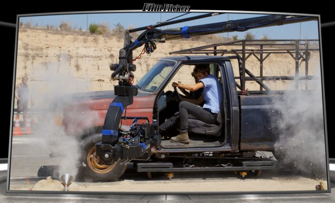 Image of behind the scene of terminator dark fate showing cameras hooked up to trucks