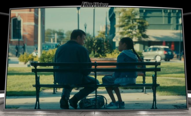 Image of two people on the bench