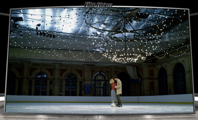 Image of two people ice skating on the ice