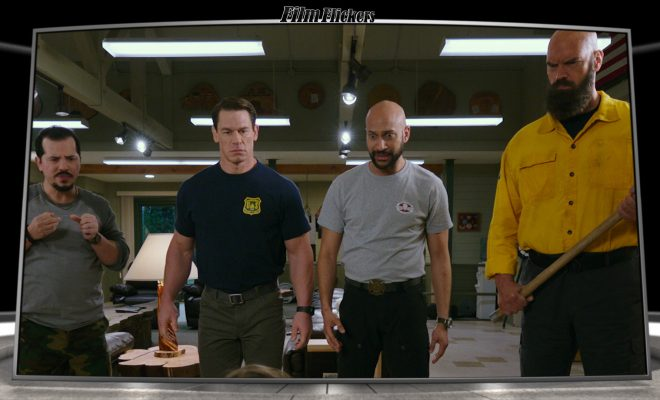 Image of four guys in fire station