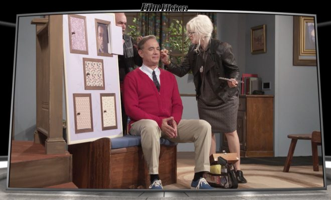 Image of Tom Hanks getting make placed on his face behind the scenes as Mr. Rogers
