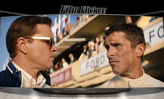 Image of Matt Damon and Christian Bale looking at each other in a scene from Ford v Ferrari