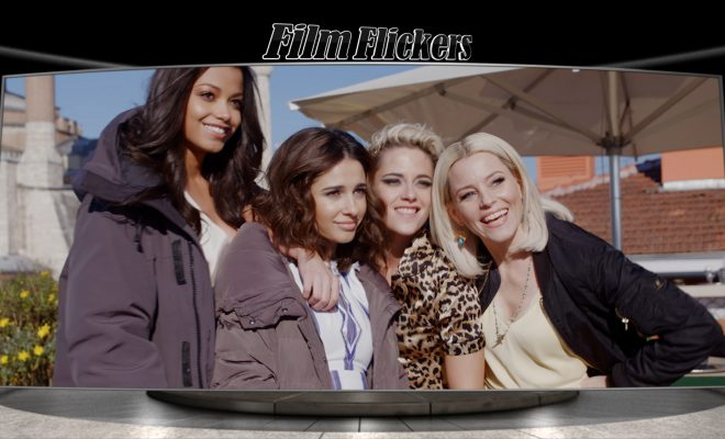 Image of Ella Balinska, Naomi Scott, Kristen Stewart and Elizabeth Banks taking a group photo on set