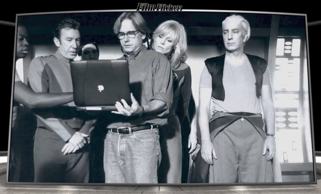 Image of behind the scenes look at the cast of Galaxy Quest looking at the director's laptop for direction