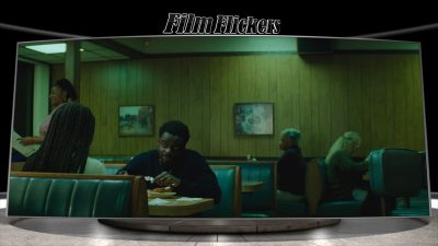 Image of Queen and Slim at a diner eating