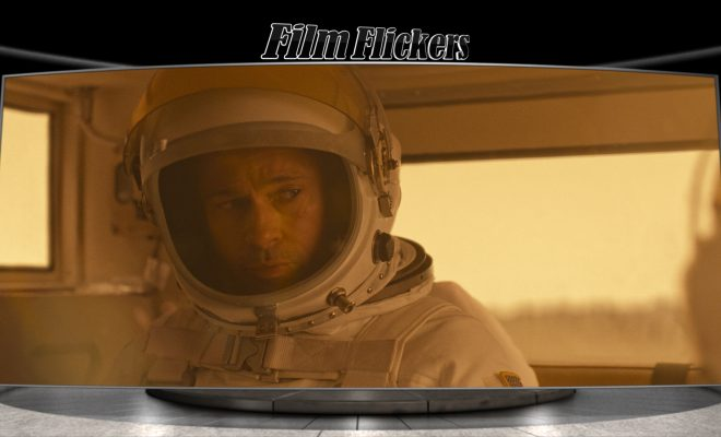 Image of Brad Pitt in astronaut suit riding inside a car on a different planet