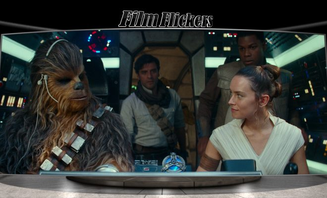 Image of Rey and Chewbaca sitting up front on ship looking at each other