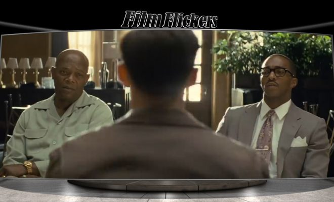 Image of Samuel Jackson and Anthony Mackie talking to Nicholas Hoult in The Banker