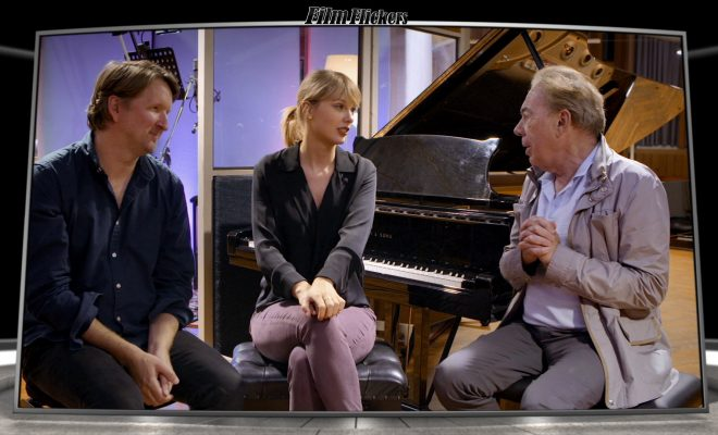 Image of Taylor Swift talking with two guys about creating a new number for movie Cats