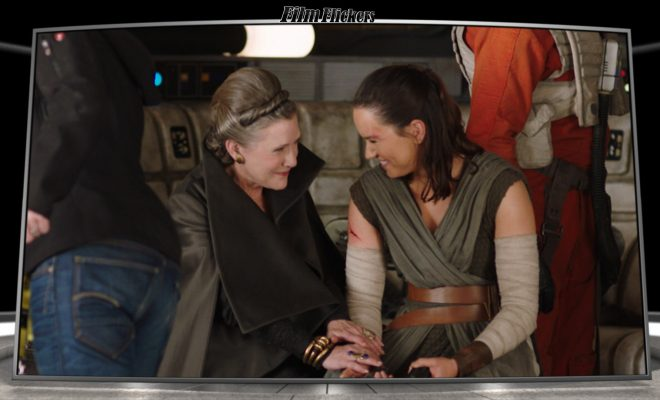 Image of Rey and Leia sharing a moment on set during Star Wars filming