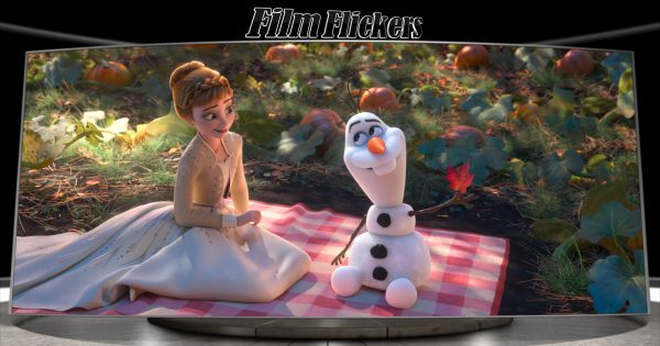 Image of Anna and Olaf sitting on a picnic blanket talking