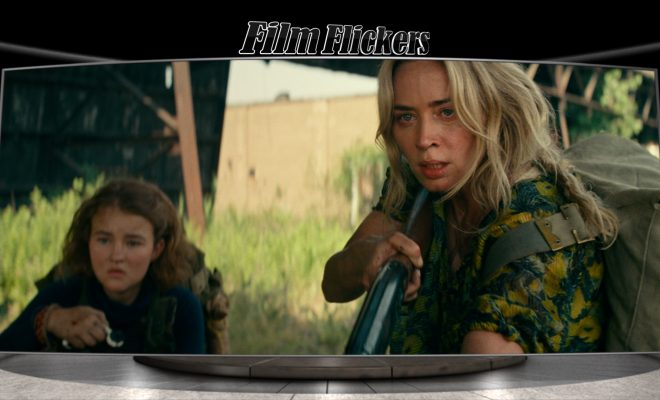 "Image of Emily Blunt and a child looking scared with gun in hand in ""A Quiet Place Part II"""