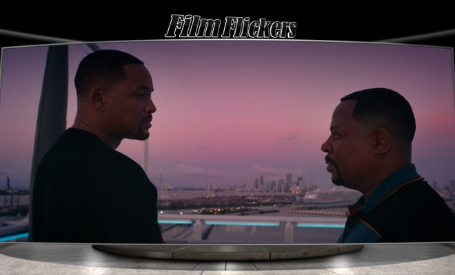 "Image of Will Smith and Martin Lawrence looking at each other with a city skyline behind them in ""Bad Boys For Life"" movie"