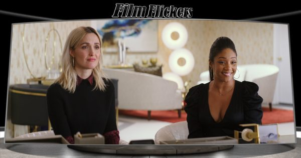 """Image of Tiffany Haddish and Rose Byrne sitting in an office from """"Like A Boss"""" film"""