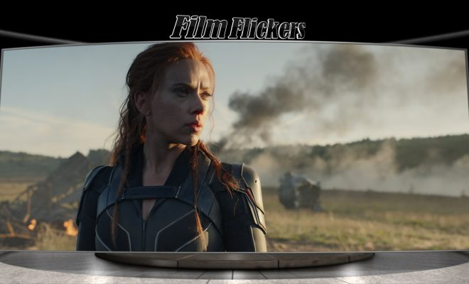 Image of Scarlet Johansen as Black Widow looking out in to the field