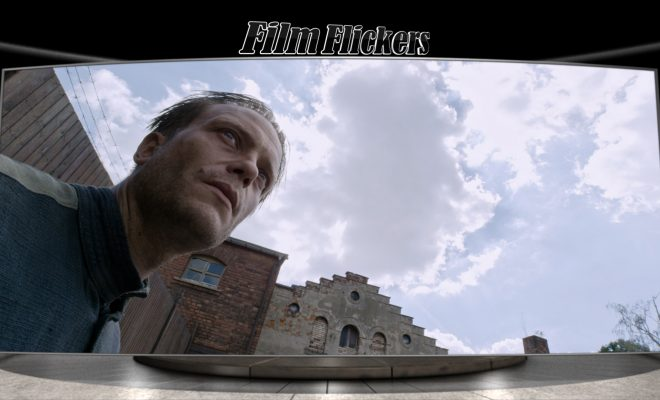 "Image of a guy looking up off screen in ""A Hidden Life"" film"
