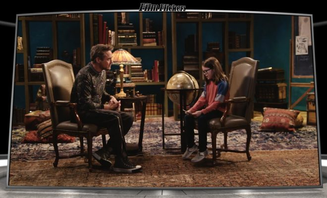 "Image of a kid interviewing Robert Downey Jr. about film ""Dolittle"""