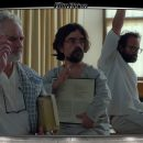 "Image of three guys with their hands raised in ""Three Christs"" film"