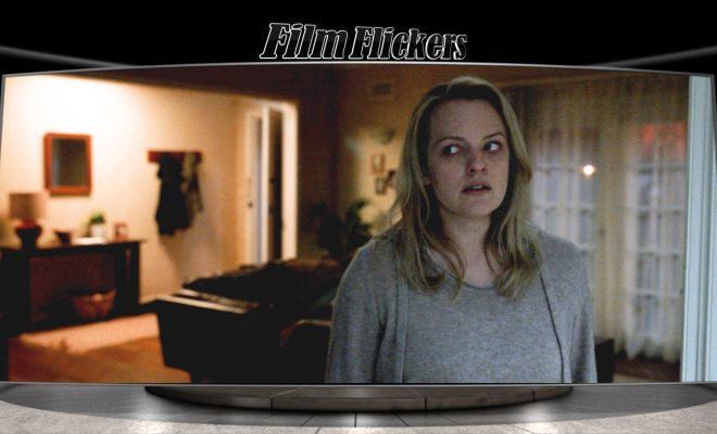 "Image of Elisabeth Moss in ""The Invisible Man"" looking scared in her house"