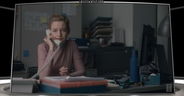 Julia Garner's character in her office talking on the phone