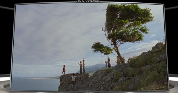"""Image of kids standing near a cliff on Neverland from the film """"Wendy"""""""