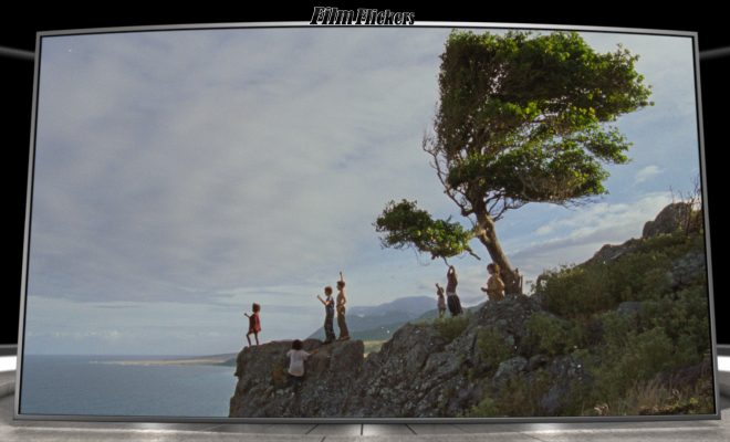 "Image of kids standing near a cliff on Neverland from the film ""Wendy"""