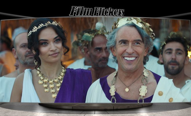 """Image of a couple dressed as roman royalty at a party in the film """"Greed"""""""