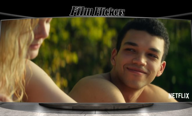 "Image of Justice Smith lovingly looking at Elle Manning in the film ""All The Bright Places"""